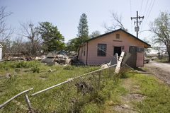 Ninth Ward Home. A pink wood house in the heavily damaged section of New Orleans Ninth Ward.  The flood waters from hurricane katrina have knocked the home off Royalty Free Stock Photography