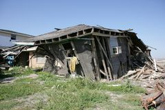 Ninth Ward house with jersey. After Hurricane Katrina a yellow sports Jersey hangs off a destroyed home in the Ninth Ward of New Orleans Stock Photography