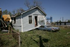 Ninth Ward House lands on Car. In the heavily damaged Ninth Ward of New Orleans a house now sits ontop of a car parked in the driveway. In between houses a boat Stock Photo
