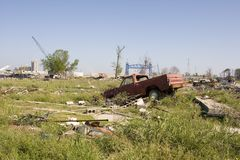 Ninth Ward landscape 4368. A vast emty lot where a neighborhood once stood. The flood waters of hurricane Katrina breached the levy wall seen in the background Royalty Free Stock Image