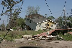 Ninth Ward Yellow House off foundation. In the heavily damaged Ninth Ward of New Orleans a home sits off it's foundation Stock Photo