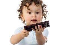 Niño con el chocolate. Foto de archivo libre de regalías