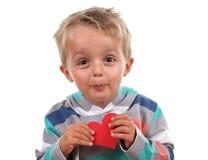 Niño con el corazón del amor Fotografía de archivo