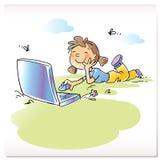 Niño con el ordenador portátil Foto de archivo