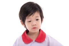 Niño con un párpado hinchado Foto de archivo