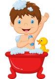 Niño de la historieta que toma un baño Foto de archivo libre de regalías