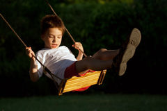 Niño en el oscilación Imágenes de archivo libres de regalías
