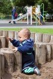 Niño en el patio Fotografía de archivo libre de regalías