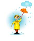Niño en la lluvia. Foto de archivo