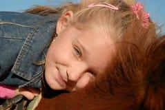 Niño en potro Fotografía de archivo