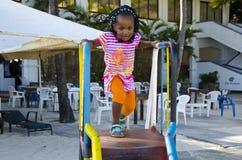 Niño en una diapositiva Imagen de archivo libre de regalías