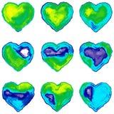 Nio färgrika hjärtor som simulerar vattenfärgen på papper royaltyfri fotografi