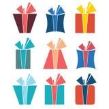 nio färgrika symboler av gåvaaskar Arkivfoto