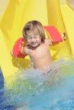 Niño feliz en aquapark Fotos de archivo libres de regalías