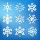 Nio gulliga snöflingor Arkivbild