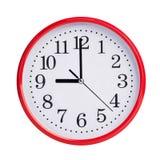 Nio klockan på en rund visartavla Royaltyfri Bild