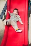 Niño lindo en diapositiva Fotografía de archivo