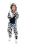 Niño pequeño como vaca con la botella de leche Imagenes de archivo