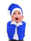 Niño pequeño en el traje azul de Santa Claus Fotos de archivo libres de regalías