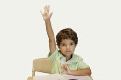 Niño que aumenta la mano Foto de archivo libre de regalías