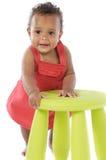 Niño que juega con una silla Imagen de archivo libre de regalías