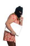 Niño que roba la computadora portátil Imágenes de archivo libres de regalías