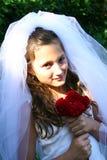 Niño que se viste para arriba como novia Foto de archivo