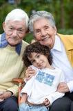 Niño y abuelos Imágenes de archivo libres de regalías