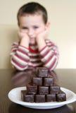 Niño y chocolate Foto de archivo libre de regalías