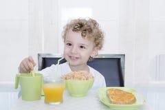 Niño y desayuno Fotografía de archivo libre de regalías