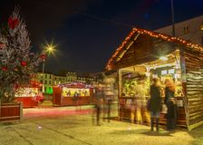 Craftsman`s cottages with illuminations of Christmas around on the main square of downtown nio Stock Photo