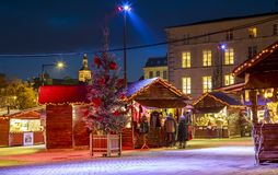 craftsman`s cottages with illuminations of Christmas and people around on the main square of d Stock Photography