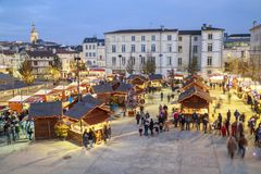 Panoramic view of christmas market at night during the festive period vendors sell from tempora Royalty Free Stock Photography