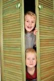 Niños del armario Foto de archivo libre de regalías
