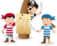 Niños del pirata que miran el mapa Foto de archivo