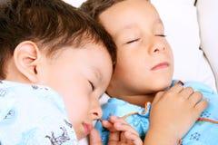 Niños durmientes Fotografía de archivo libre de regalías