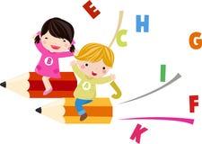 Niños e inglés de la diversión Foto de archivo libre de regalías