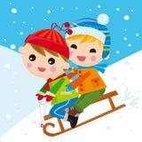 Niños en la nieve llevada Fotografía de archivo