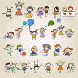 Niños felices del personaje de dibujos animados del dibujo de la mano Imágenes de archivo libres de regalías