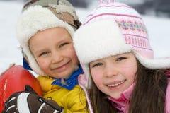 Niños felices en invierno Foto de archivo libre de regalías