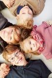 Niños felices en un círculo Imagen de archivo