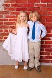Niños felices que abrazan y que sonríen Fotos de archivo libres de regalías