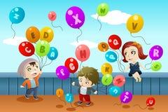 Niños que aprenden alfabetos Imagen de archivo libre de regalías