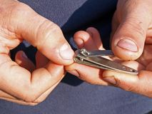 Nip fingernails Stock Image