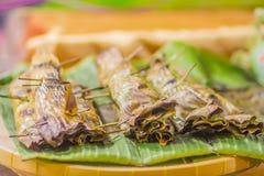 Nipa palm dessert Khanom jaak, Thai sweetmeat made of flour, coconut and sugar, wrapped in nipa palm leaves and grilled. Nipa palm dessert Khanom jaak, Thai stock photography