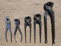 Nippers. Lot of hand work tools, different model of used nippers on brown background Stock Images