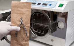 Nippers for manicure on the background of an autoclave. Background blurred Royalty Free Stock Image