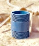 Nipple for connecting PVC pipes. Threaded nipple to connect the PVC pipe Royalty Free Stock Images