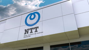 Nippon Telegraph and Telephone Corporation NTT logo on the modern building facade. Editorial 3D rendering Stock Photography