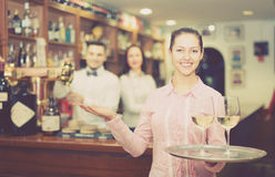 Nippy with beverages and bar crew. Cheerful nippy with beverages and bar crew at background Stock Photography